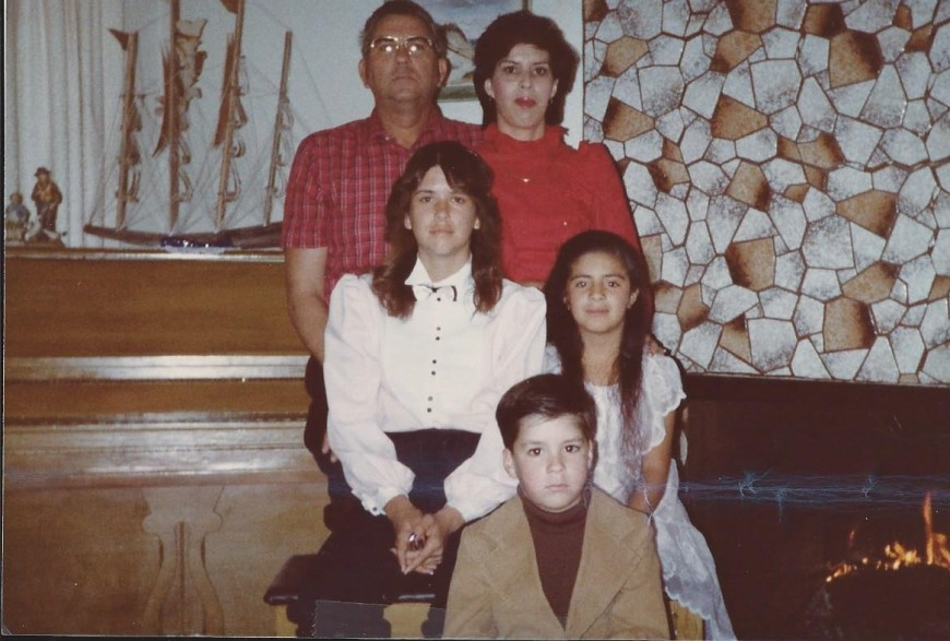 Me at age ten, seated in center on right near fireplace. Not a picture perfect family, but at least my folks didn't drink or abuse me. So what's my excuse???